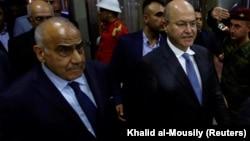 Ирактың жаңа сайланған президенті Бархам Салих (оң жақта) пен жаңа премьер-министрі Адел Абдул-Махди. Бағдад, 2 қазан 2018 жыл.