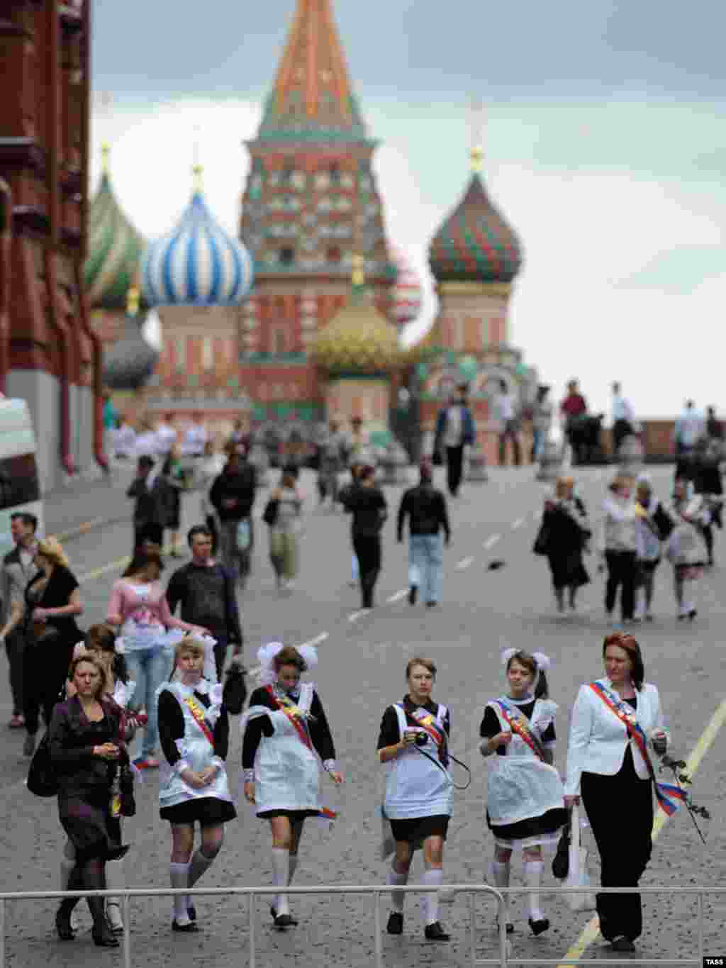 Russian students celebrate the last day of the school year in Moscow's Red Square. - Photo by ITAR-TASS