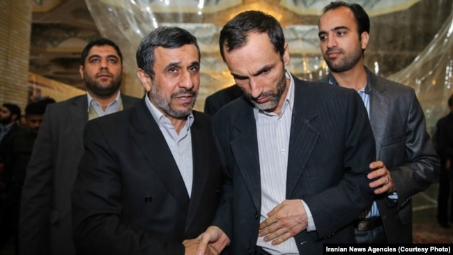 Mahmud Ahmadinejad (left) speaking with his former vice president and close aide Hamid Baghaei (file photo)