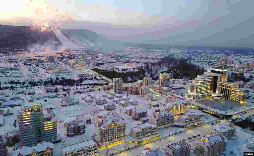 "Samjiyon's ski slope is visible as fireworks explode over the city. A state media outlet said, without elaborating, that the town had been constructed despite ""the worst trials"" and ""ordeals and difficulties."""