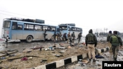 The wreckage of a bus after an attack that killed more than 40 Indian soldiers on February 14.