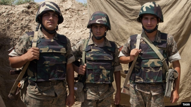Nagorno-Karabakh -- Armenian soldiers pose for a photo in the town of Agdam, 23Aug2012