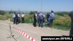 Armenia - Law-enforcement officials inspect the site of the murder of Russian serviceman Ivan Novikov in Gyumri, 15 June, 2015