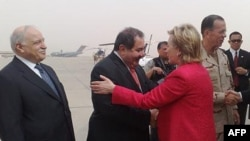 U.S. Secretary of State Hillary Clinton is greeted by Iraqi Foreign Minister Hoshyar Zebari on her arrival in Baghdad on April 25. (low quality image)