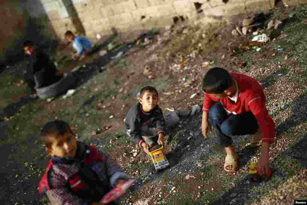 Kurdish refugee children from the Syrian town of Kobani play in a camp in the southeastern town of Suruc, Sanliurfa Province, Turkey. (Reuters/Kai Pfaffenbach)