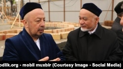 "Anvar-qori Tursunov (left) says that ""mini-mosques"" will be built to help practicing Muslims pray five times a day."