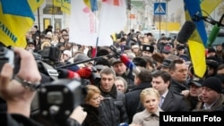 Yulia Tymoshenko speaks to the press on her way to the Prosecutor-General's Office in Kyiv.