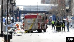 Firefighters take position after two explosions occurred near the finish line of the 117th Boston Marathon on April 15.