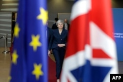 Theresa May a discutat în mai multe rânduri cu Klaus Iohannis despre statutul românilor din Marea Britanie în cazul unui Brexit fără acord
