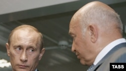 Luzhkov (right) with Putin last year