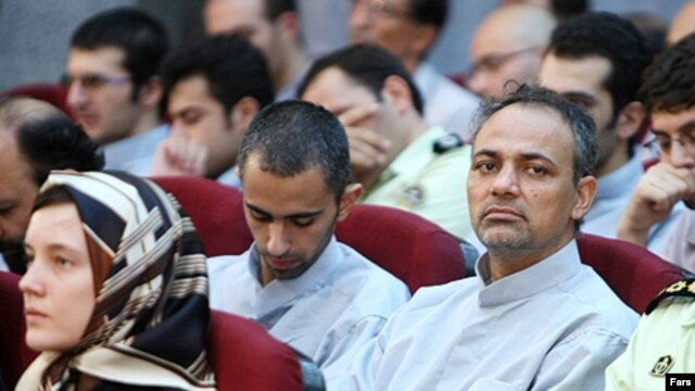 French national Clotilde Reiss (left) sits among fellow defendants in the trial that opened on August 8, including Iranian journalist Ahmad Zeidabadi (right)
