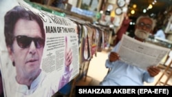 A newspaper bears news of the controversial victory of Imran Khan's Pakistan Tehrik-e Insaf party in the July 25 vote.
