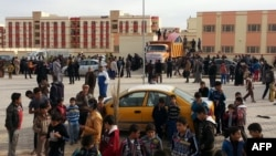 Diplaced Iraqis seeking refuge gather in a residential area on the outskirts of the city of Ramadi after fleeing ongoing battles between the Iraqi Army and antigovernment fighters in Anbar Province.