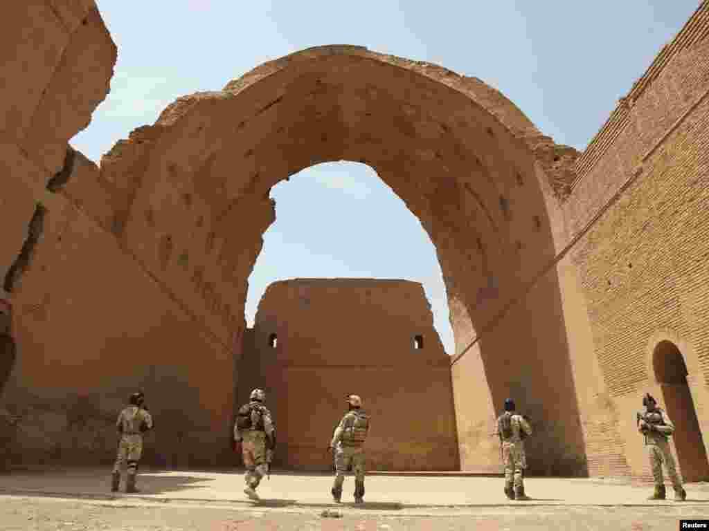 Iraqi soldiers provide security near the ancient Arch of Ctesiphon during a search operation in Salman Pak, about 30 kilometers outside Baghdad. Photo by Saad Shalash for Reuters.