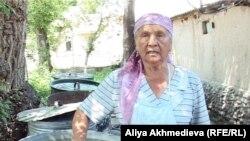Пенсионерка Алия Джабакова, жительница поселка Хоргос. Алматинская область, 27 мая 2011 года.