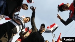 Supporters of Iraqi cleric Muqtada al-Sadr demonstrate in Baghdad on February 8.
