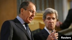 Russian Foreign Minister Sergei Lavrov (left) with U.S. Secretary of State John Kerry during the G8 Foreign Ministers Meeting in London on April 11.