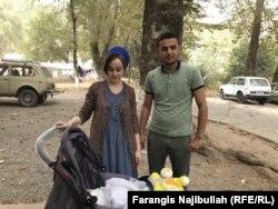 Firuz Qosimzoda with his wife and baby daughter.