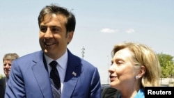 While staunch ally Georgia and its President Mikheil Saakashvili (left) can boast the most aid in the region, U.S. Secretary of State Hillary Clinton will struggle to maintian aid levels for other countries.