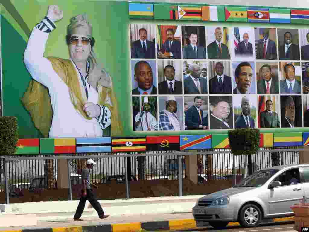 This billboard shows Qaddafi with other African leaders in the Libyan coastal city of Sirte, before the start of the Arab League Extraordinary Summit in October 2010.
