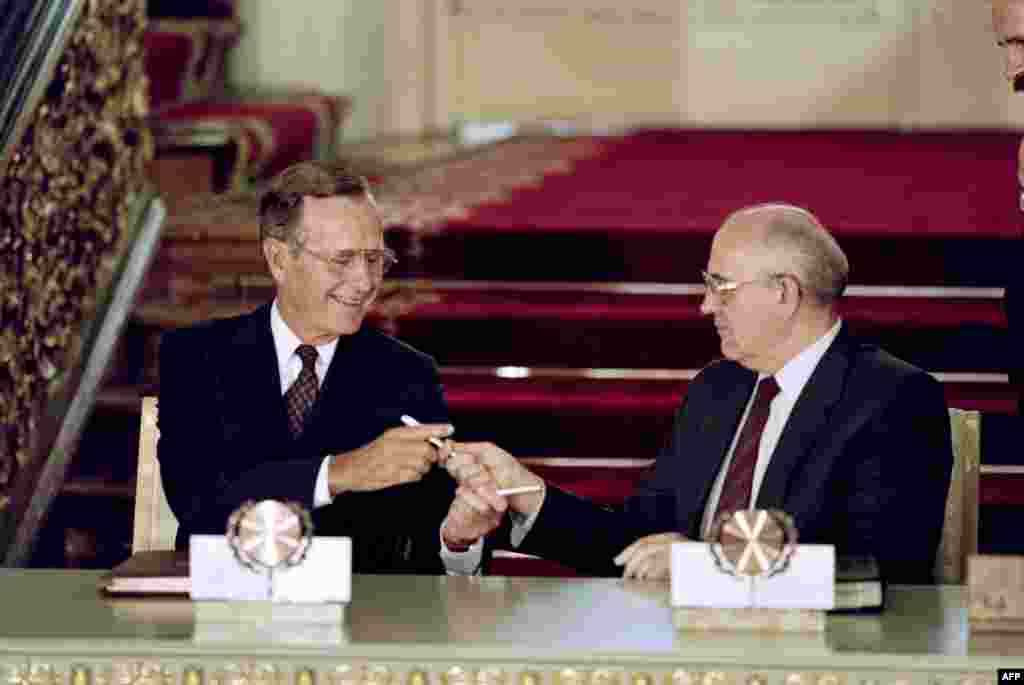 U.S. President George Bush and Gorbachev exchange pens after signing the historic Strategic Arms Reduction Treaty (START), which cut the superpowers' nuclear arsenals by up to one-third, in Moscow on July 31, 1991.