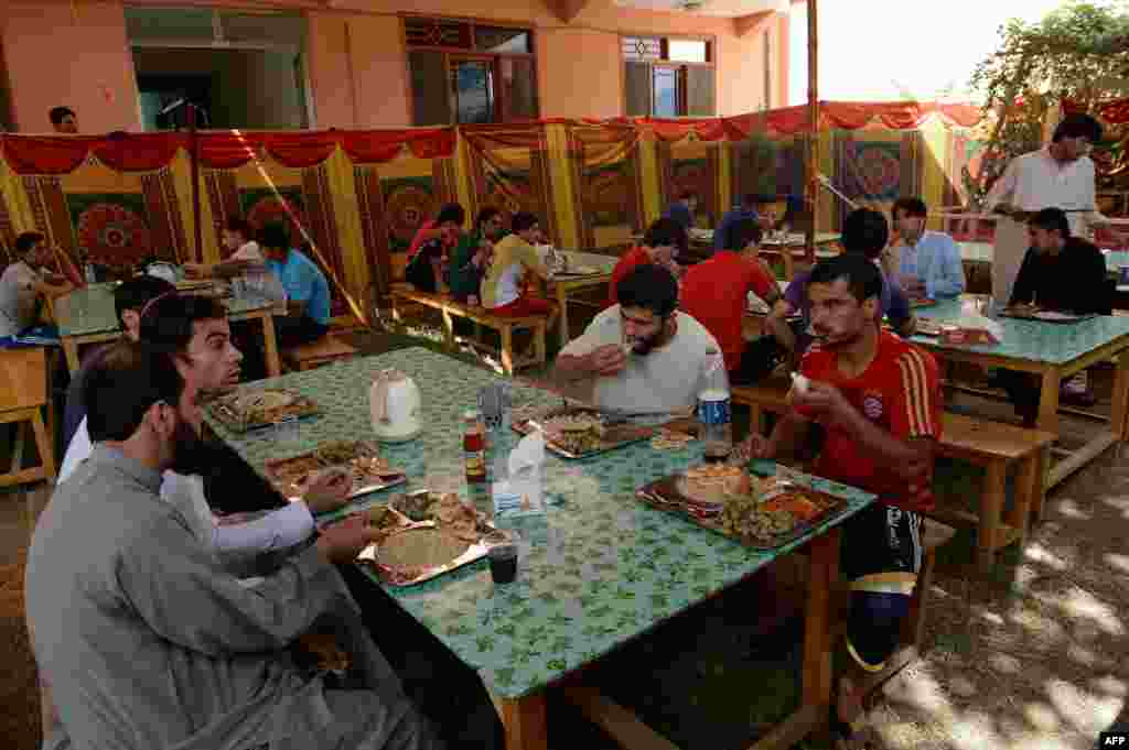 The Afghan soccer players eating lunch at their communal house in Kabul on September 2.