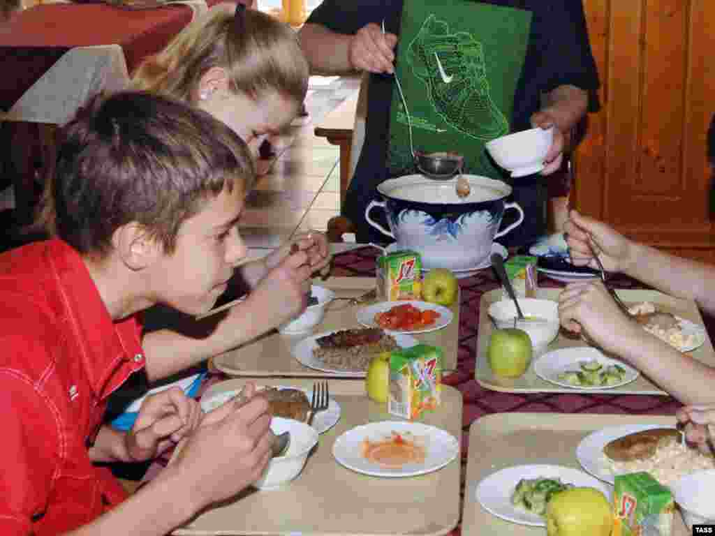 "Russian schoolchildren eating a school lunch (ITAR-TASS). - Providing at least one hot meal a day at school improves learning and can be a powerful incentive for parents in poor areas to send their children to school regularly. Plan B includes $3 billion a year to provide school lunches for every child who needs one. ""Sick children often face a lifetime of diminished productivity because of interruptions in schooling together with cognitive and physical impairment,"" says economist Jeffery Sachs."