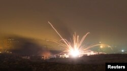 An Israeli rocket is fired into the northern Gaza Strip on July 18.