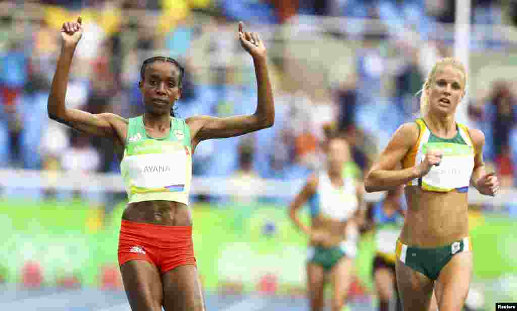 Almaz Ayana of Ethiopia celebrates victory in the women's 10,000-meter final, setting a new world record.