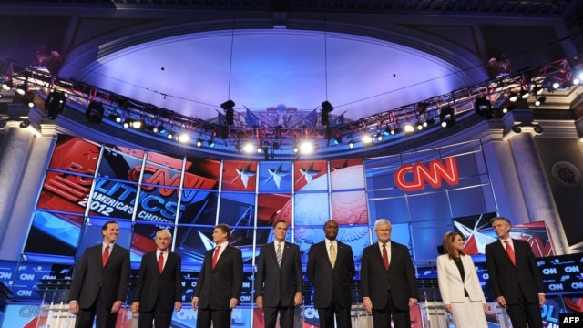 U.S. Republican presidential candidates stand on stage prior to the start of their debate on national security at the Daughters of the American Revolution Constitution Hall in Washington, D.C., on November 22.