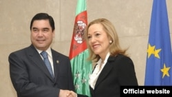 "Turkmen President Gurbanguly Berdymukhammedov with EU External Relations Commissioner Benita Ferrero-Waldner -- Bouzarovski says Europe should not ""overlook human rights abuses in a Central Asian country in the name of supposed energy-security concerns."""