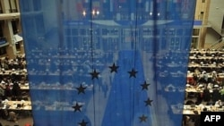 Belgium -- A press room seen through an EU flag during a European Summit at the headquarters of the European Council in Brussels, 14Mar2008