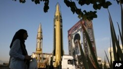 Sept. 24, 2017 file photo. Surface-to-surface missiles and a portrait of the Iranian Supreme Leader Ali Khamenei are displayed by the Revolutionary Guard.