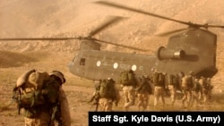 FILE: U.S. troops boarding a Chinook helicopter in Kandahar, Afghanistan.