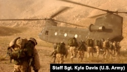 FILE: U.S. troops boarding a Chinook helicopter in the southern province of Kandahar.