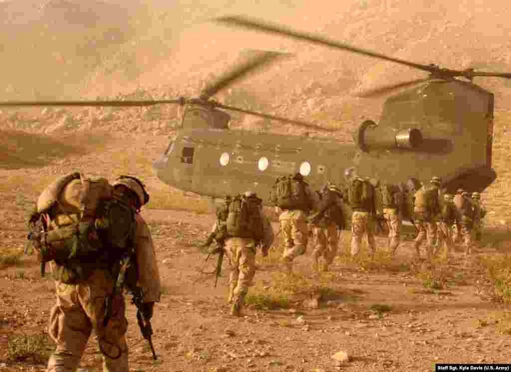 U.S. troops searching for Taliban fighters in mountains near Kandahar in 2003. After the U.S.-led invasion, most defeated Taliban melted away into mountains and villages or escaped into Pakistan.