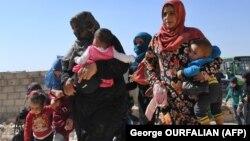 Беженцы в провинции Идлиб выходят с территории, подконтрольной повстанцам.25 сентября 2018
