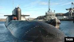 India says it will only be arming its newly commissioned nuclear submarine with conventional warheads.