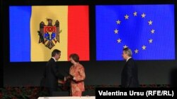 Inițierea Acordului de asociere Moldova-UE. Iurie Lancă, Catherine Ashton și Karl de Gucht, Vilnius, 29 noiembrie 2013.