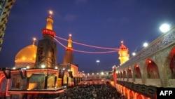 Muslim Shi'ite pilgrims gather outside the Imam Abbas shrine in Karbala on February 4.