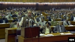 Pakistani Prime Minister Nawaz Sharif (left) speaks in parliament in Islamabad on January 29.