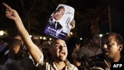 Египет -- Президенттикке талапкер Ахмед Шафиктин штабынын жанындагы нааразылык. Каир, 28-май, 2012.