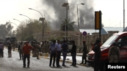 Smoke rises from the site of a bomb attack in Baghdad on March 14.