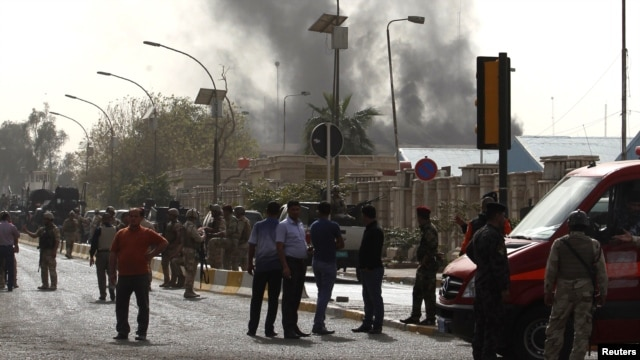 Smoke rises from the site of a bomb attack in central Baghdad on March 14.