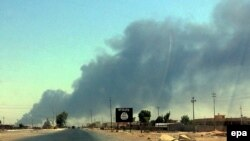Smoke rises from the Baiji oil refinery in northern Iraq, in June 2014.