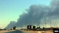 Smoke rises from the the Baiji oil refinery in northern Iraq, which the U.S. military says is under a growing threat from Islamic State militants.