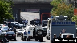 Armenia -- Armenian police officers with armored vehicles block a street during a special operation to release police officers taken hostage at the seized police station in Yerevan, Armenia, 17 July 2016.