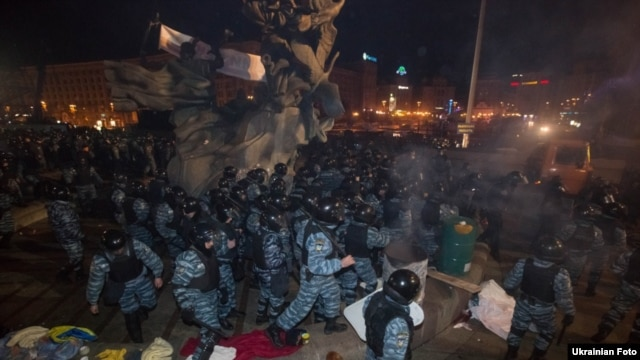 A riot police unit disperses activists in Kyiv on November 30.
