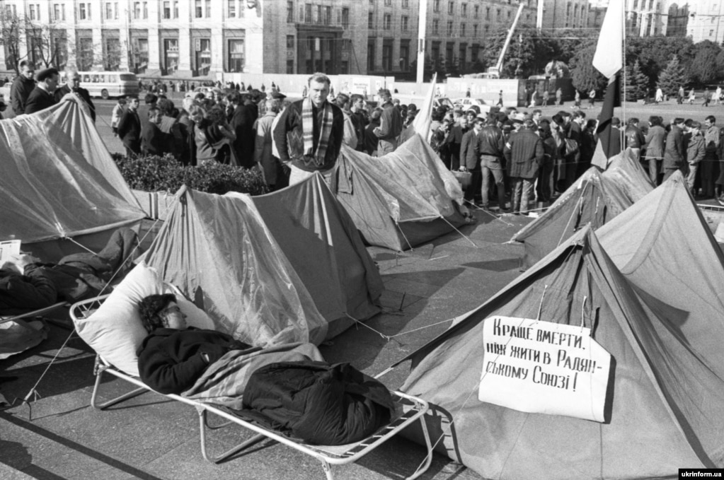 "A poster on one of the tents during the Revolution On Granite reads: ""Better to die than to live in the Soviet Union!"""