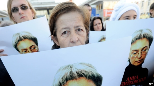 Human rights activists at a rally in honor of slain journalist Anna Politkovskaya in Moscow on October 7, 2010